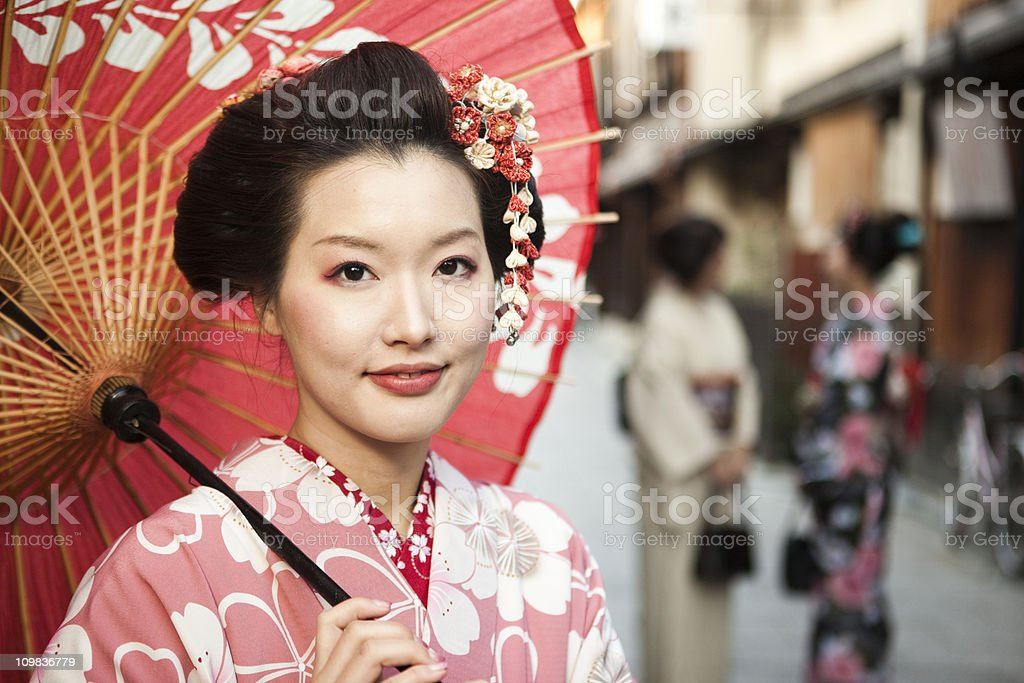 Japanese woman with a red umbrella in Kyoto, Japan stock photo