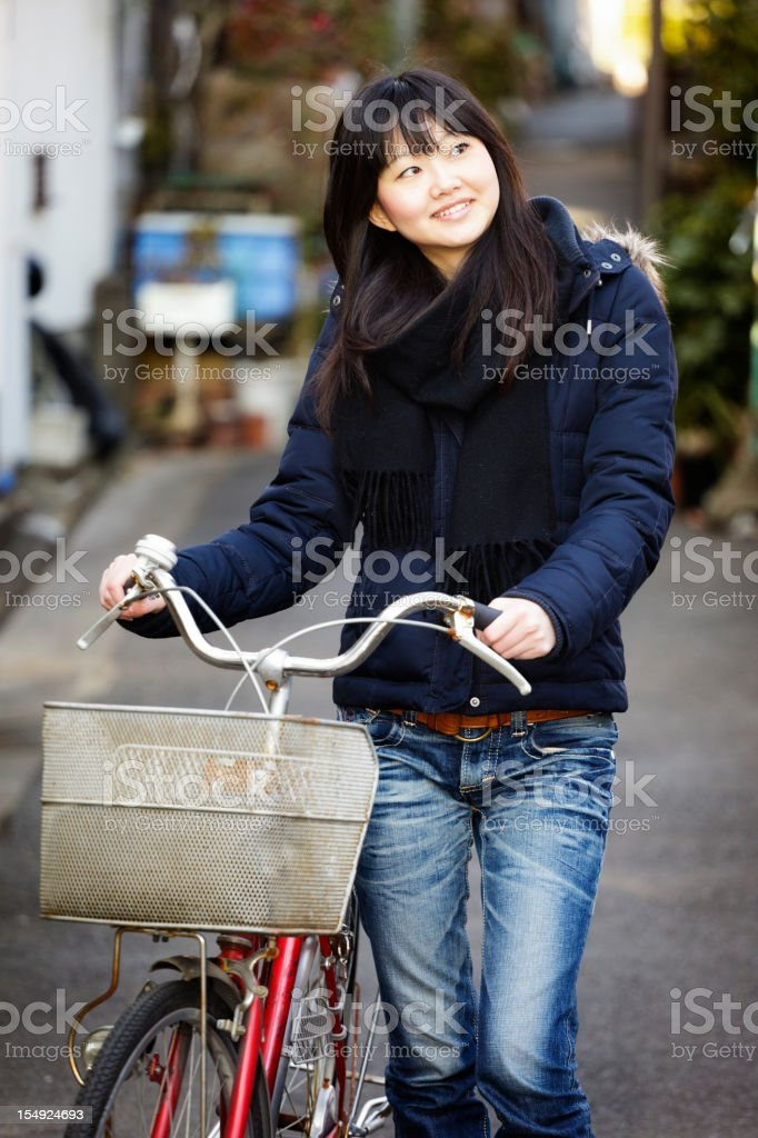 Japanese Woman with Bicycle royalty-free stock photo