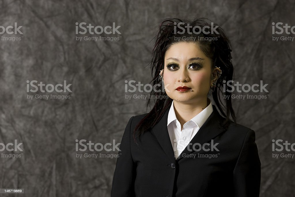 Japanese woman with body piercings royalty-free stock photo