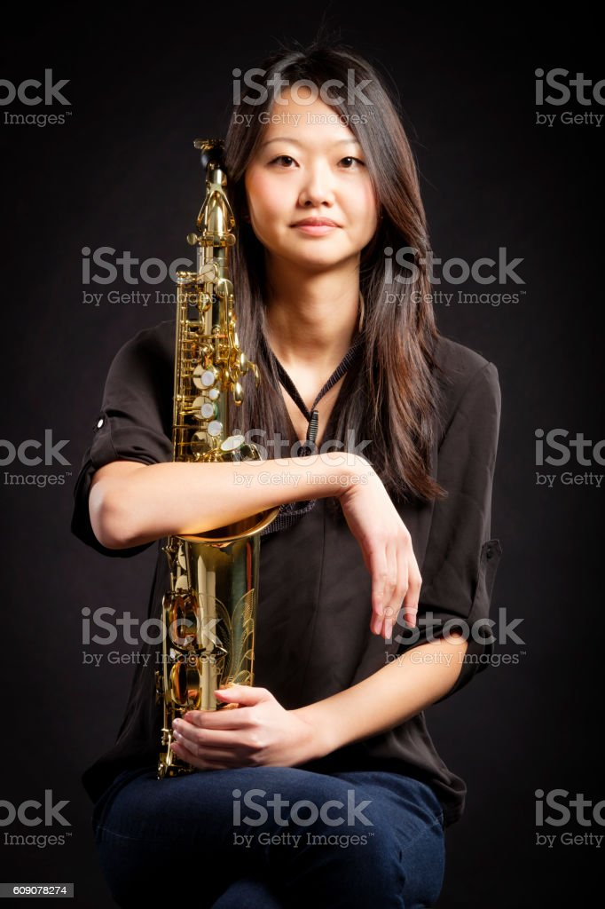 Japanese Woman with Saxophone stock photo