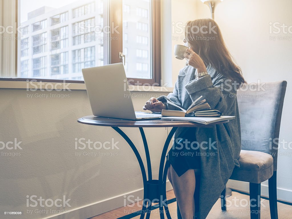 Japanese woman working at home stock photo