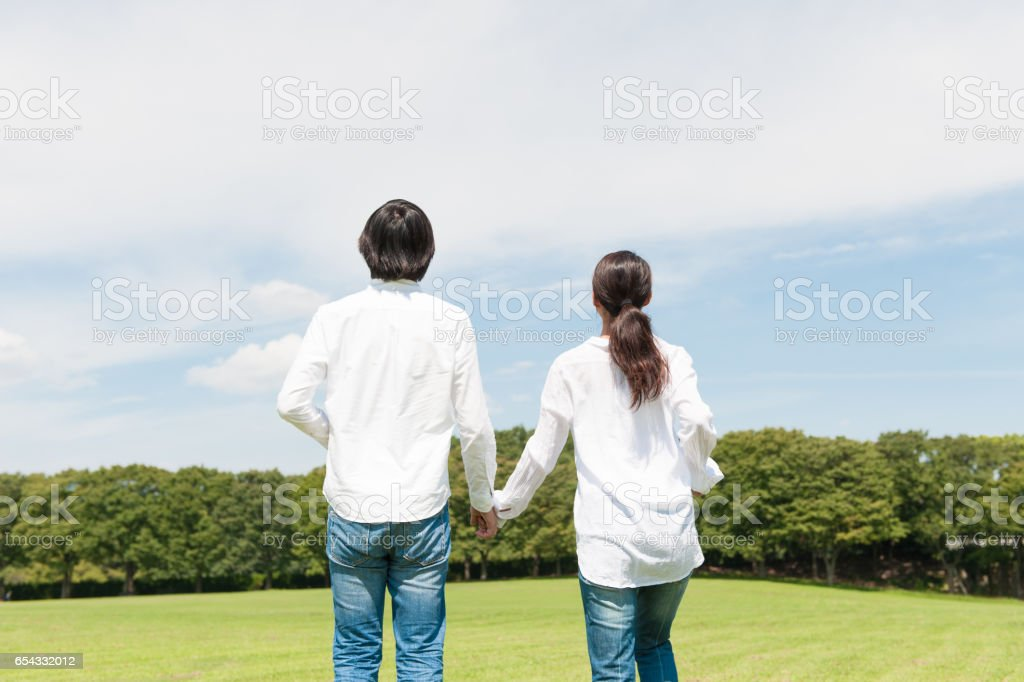 Japanese women and Japanese men holding hands in the sky stock photo