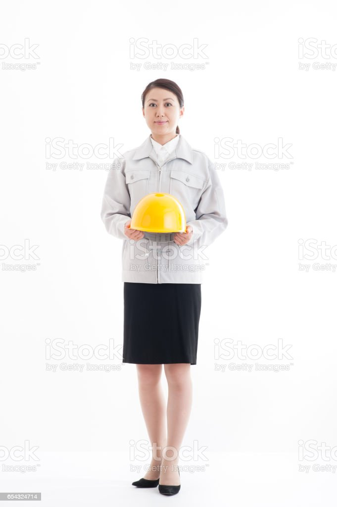Japanese women dressed in work clothes have a helmet full length portrait stock photo