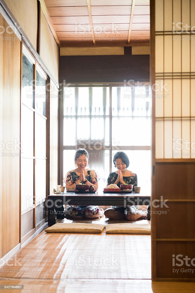 Japanese women give thanks for their meal in restaurant stock photo