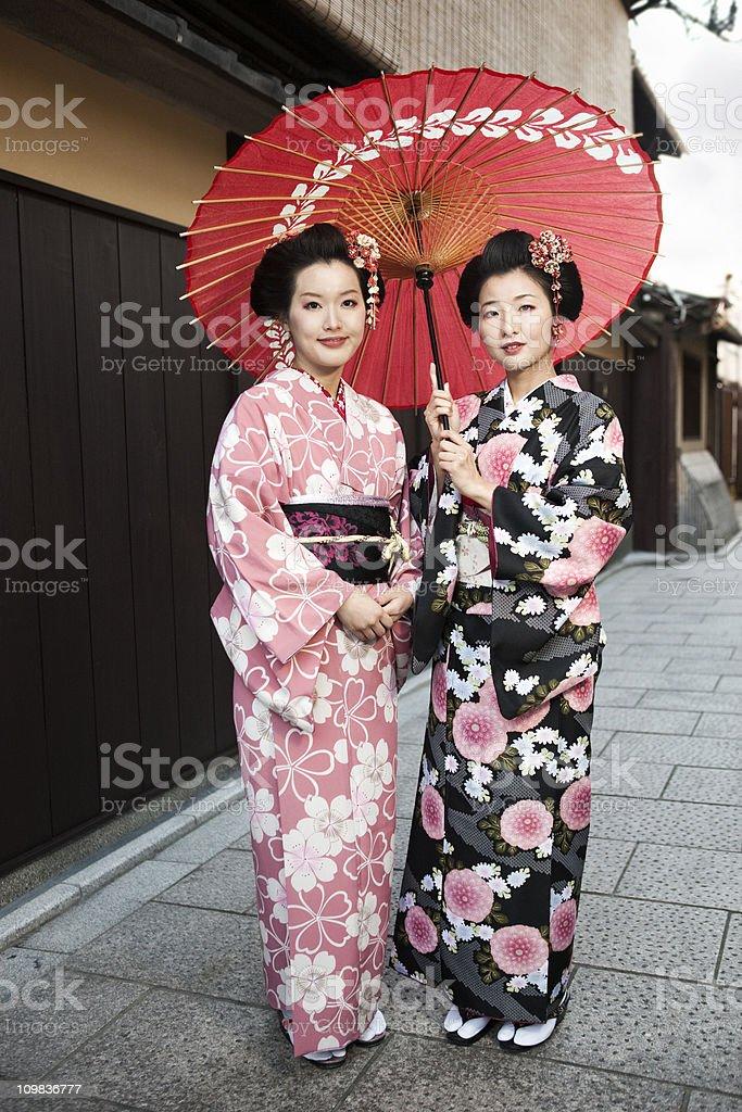 Japanese Women in Kimono and Parasol royalty-free stock photo