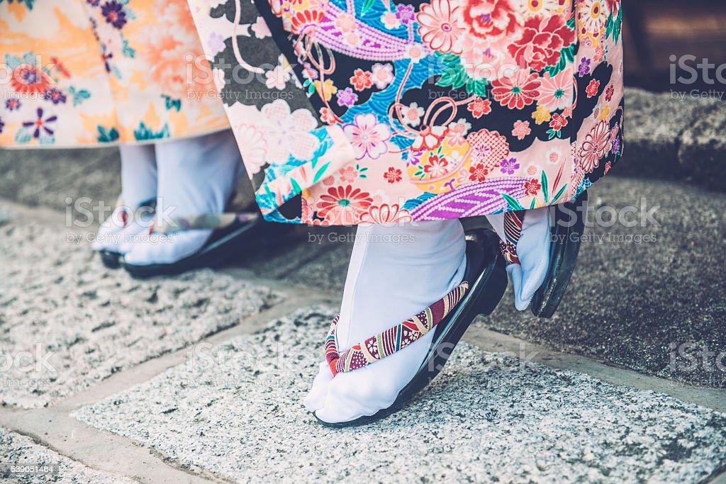 Japanese Women in Kimono Wearing Tabi and Getas, Kyoto, Japan stock photo