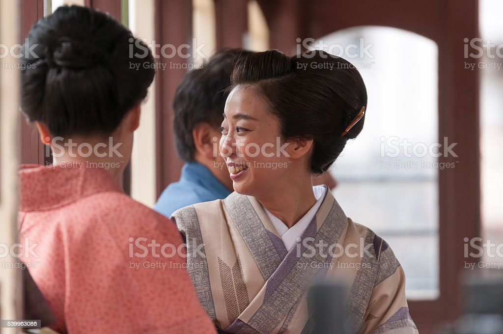 Japanese women in Yukata on a train stock photo