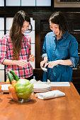 Japanese women preparing dinner