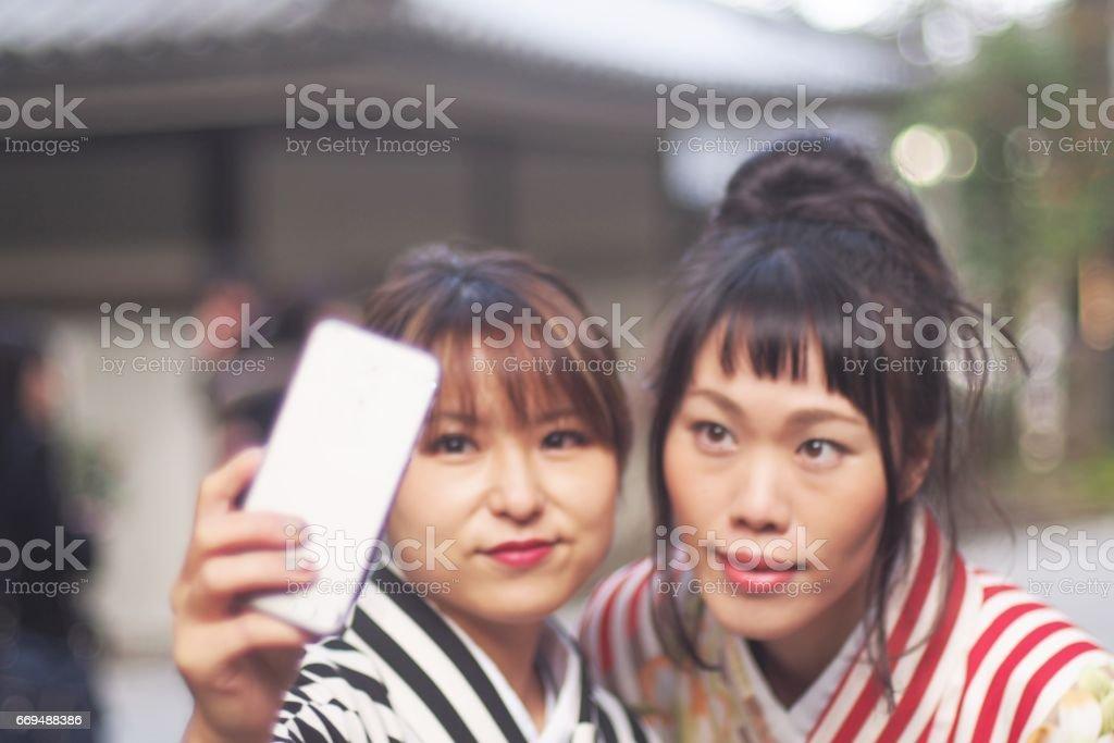 Japanese women taking a selfie in kimono stock photo
