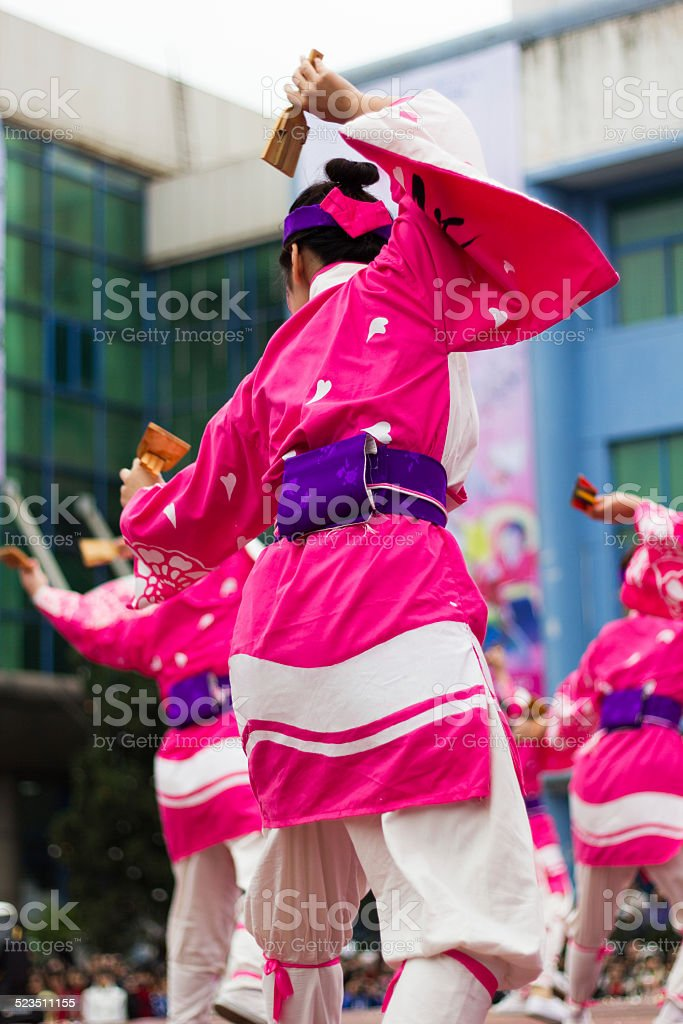 Japanese women wearing kimono dancing in line at a festival stock photo
