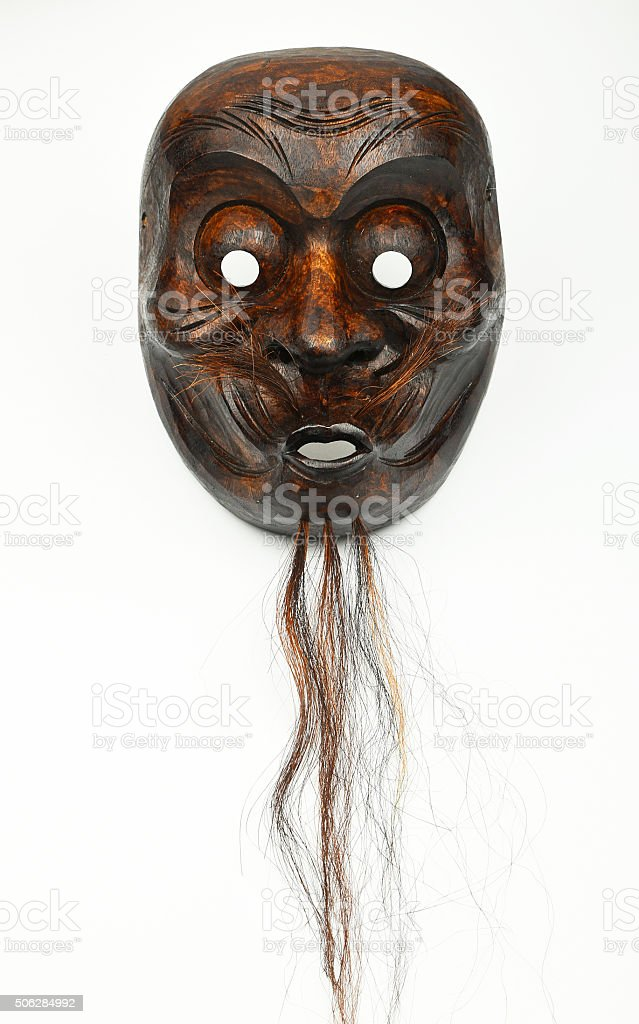 Japanese wooden theater human face mask isolated on white royalty-free stock photo