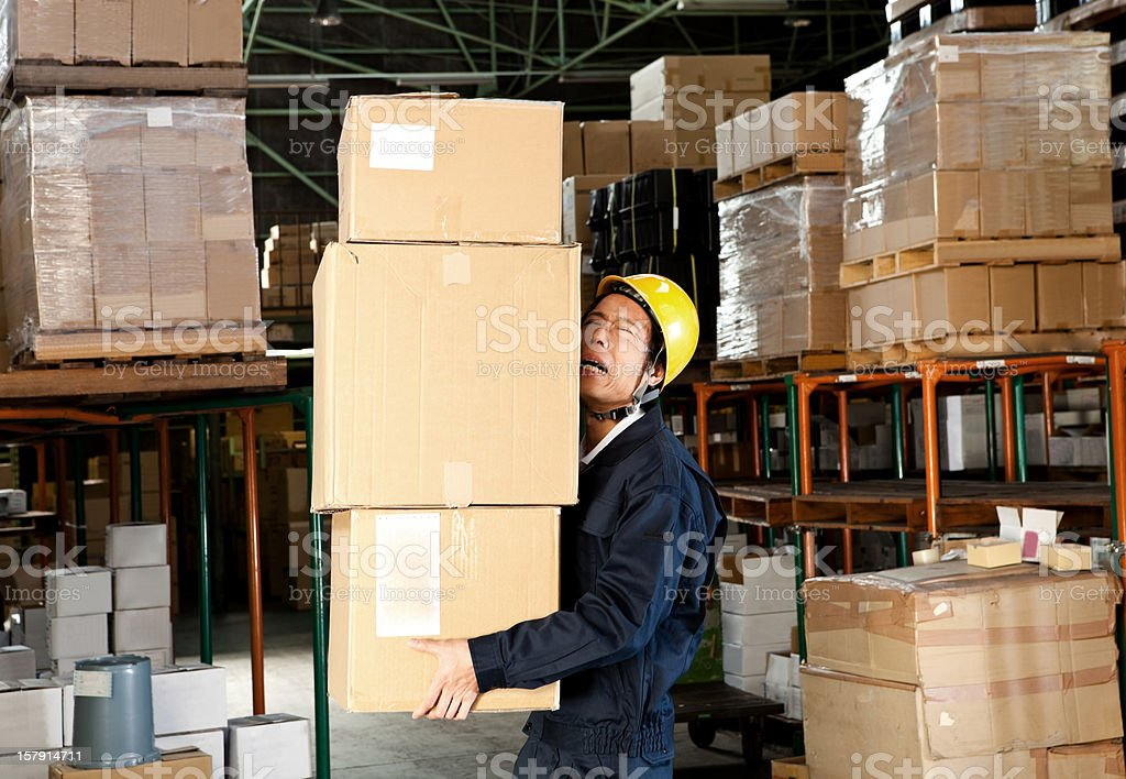 Japanese worker in a warehouse royalty-free stock photo