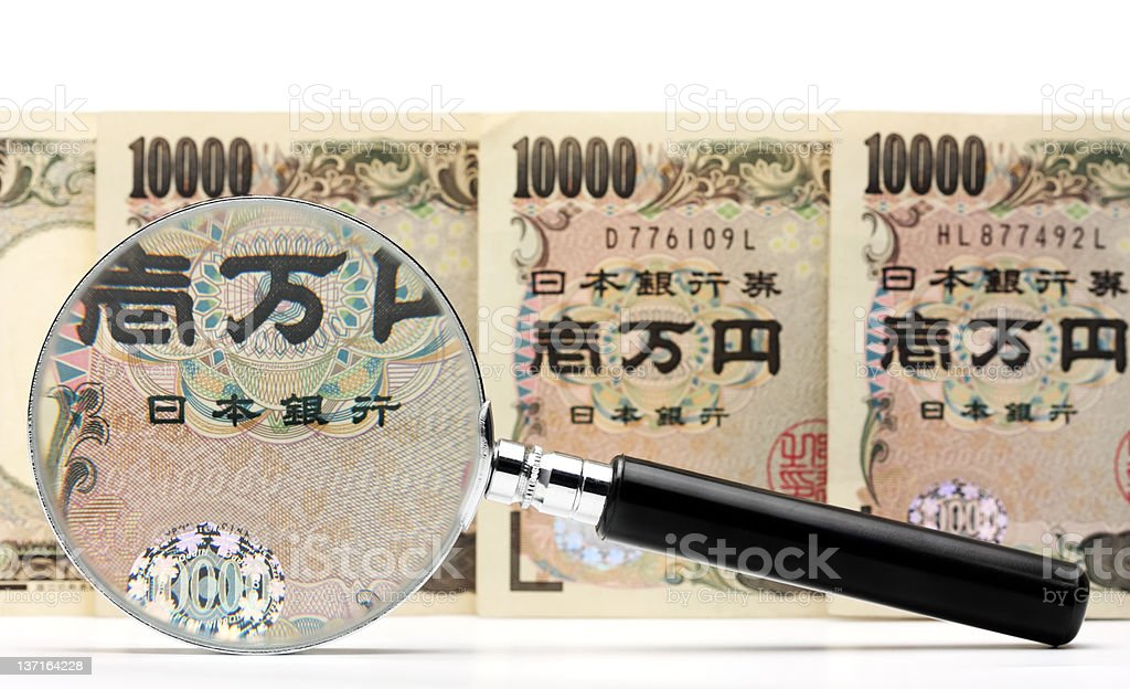 Japanese yen and magnifying glass royalty-free stock photo