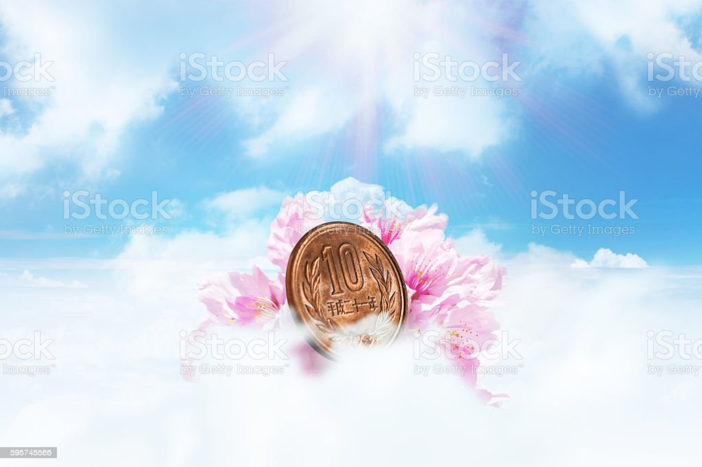 Japanese Yen with Pink Cherry Blossom in the Sky stock photo