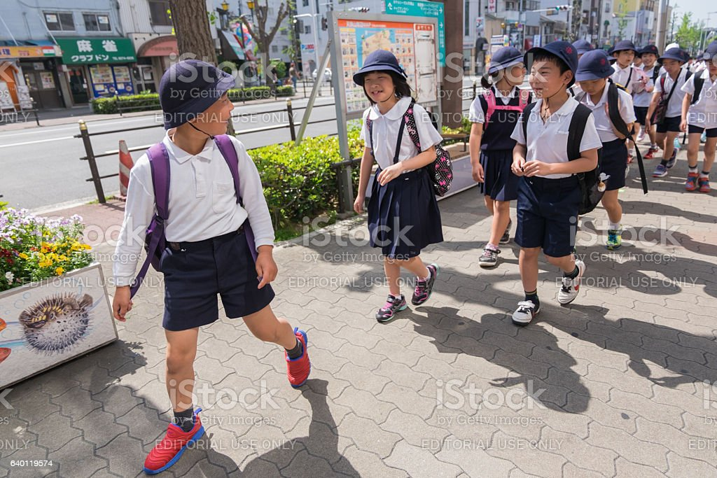 Japanese young elementary students are having field trip in Osaka stock photo