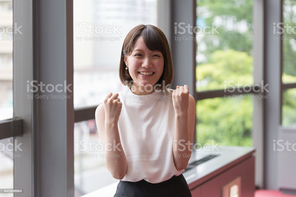Japanese  young woman is showing positive attitude stock photo