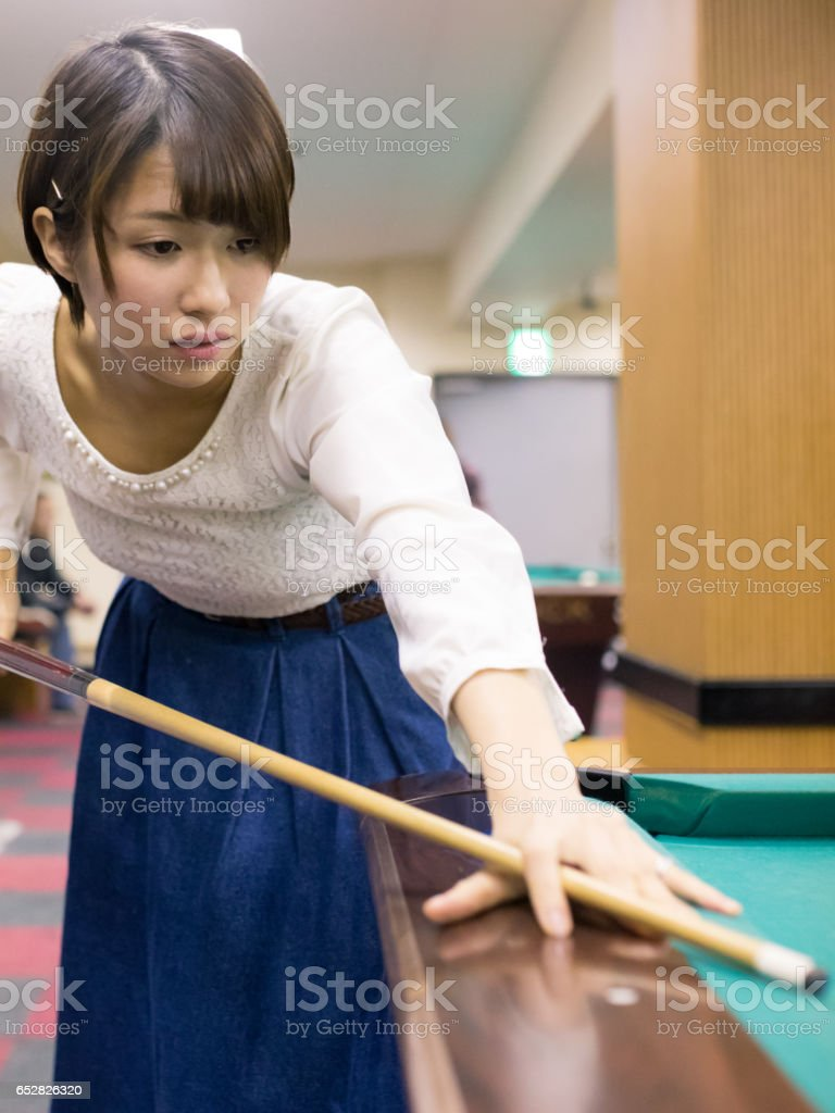 Japanese Young woman playing billiards stock photo