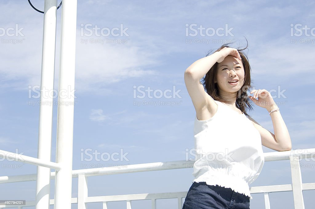 Japanese young woman standing on the deck of ferry stock photo