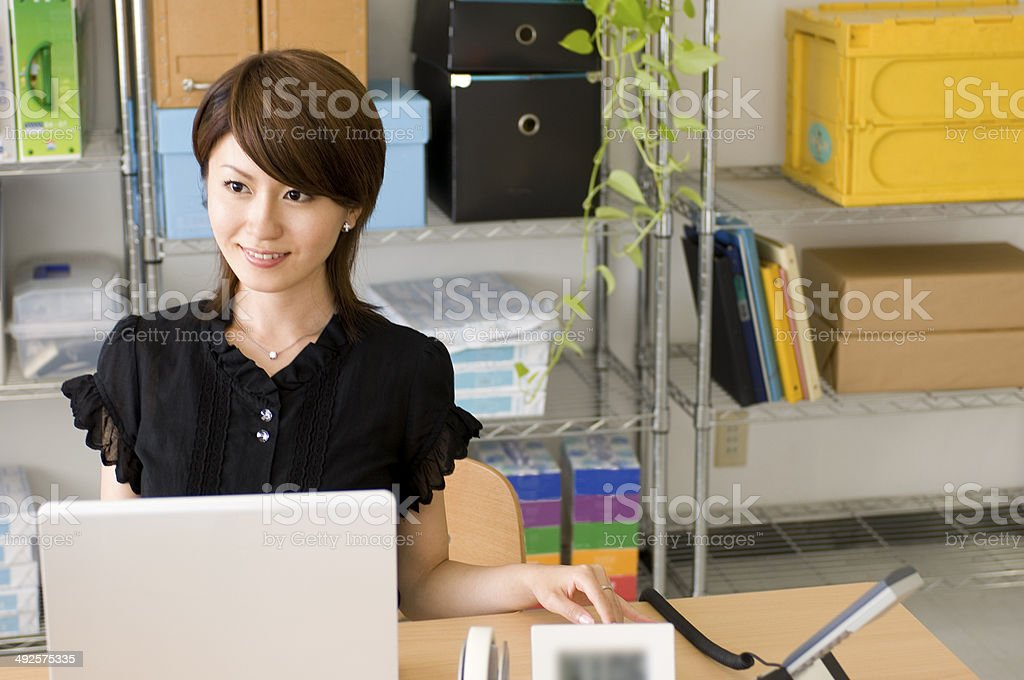 Japanese young woman working at desk stock photo