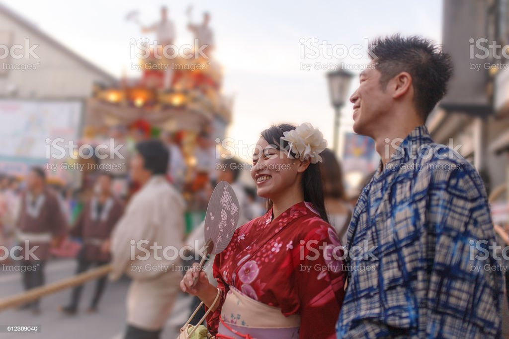 Japanese Yukata couple enjoy watching parade stock photo