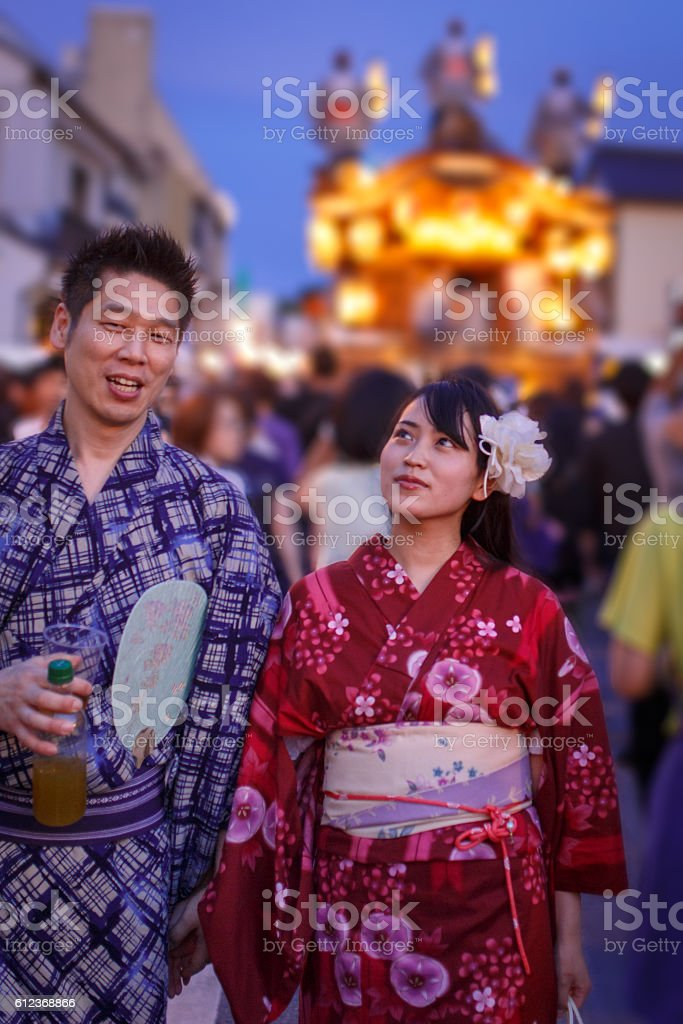Japanese Yukata couple walking on festive street stock photo