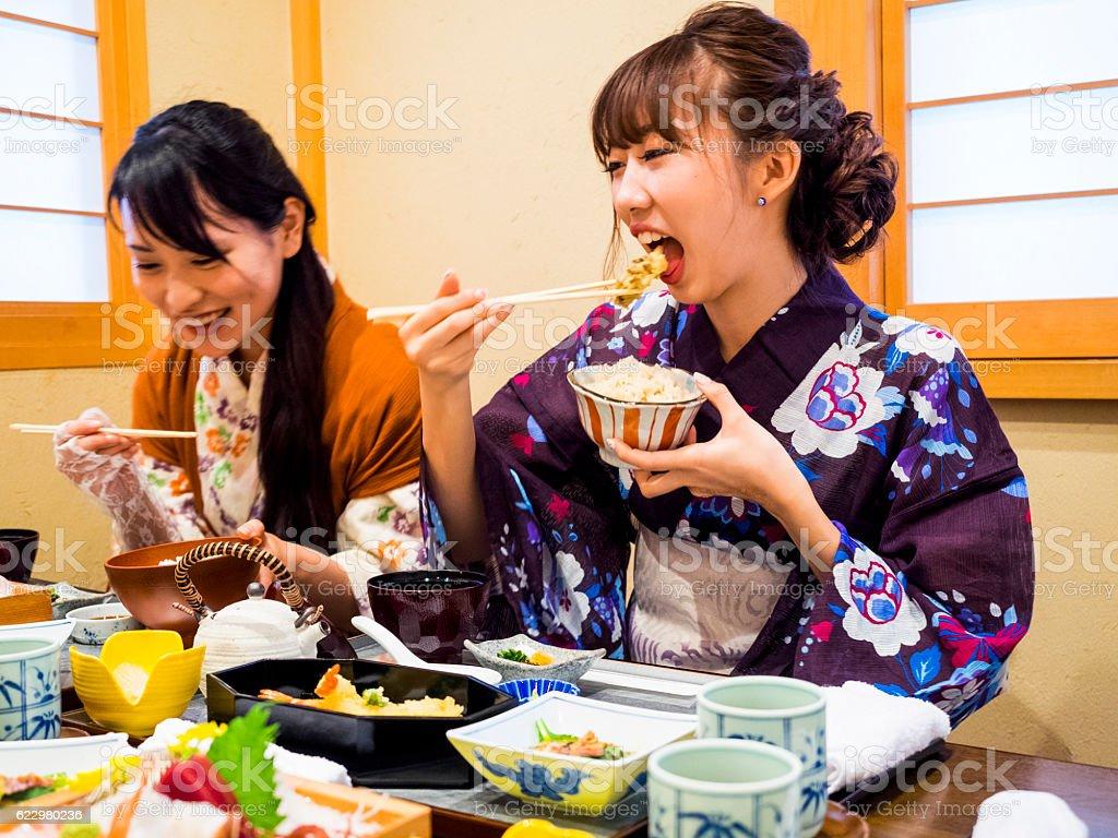 Japanese Yukata women having lunch at Japanese restaurant