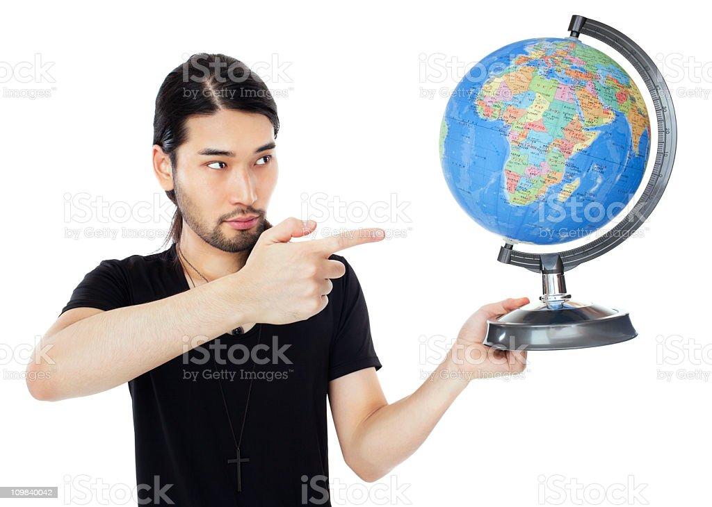 Japanse man pointing at globe royalty-free stock photo