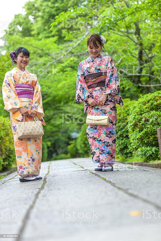 Japenese Girl in Kimono walking,talk,park,Kyoto,Japan stock photo