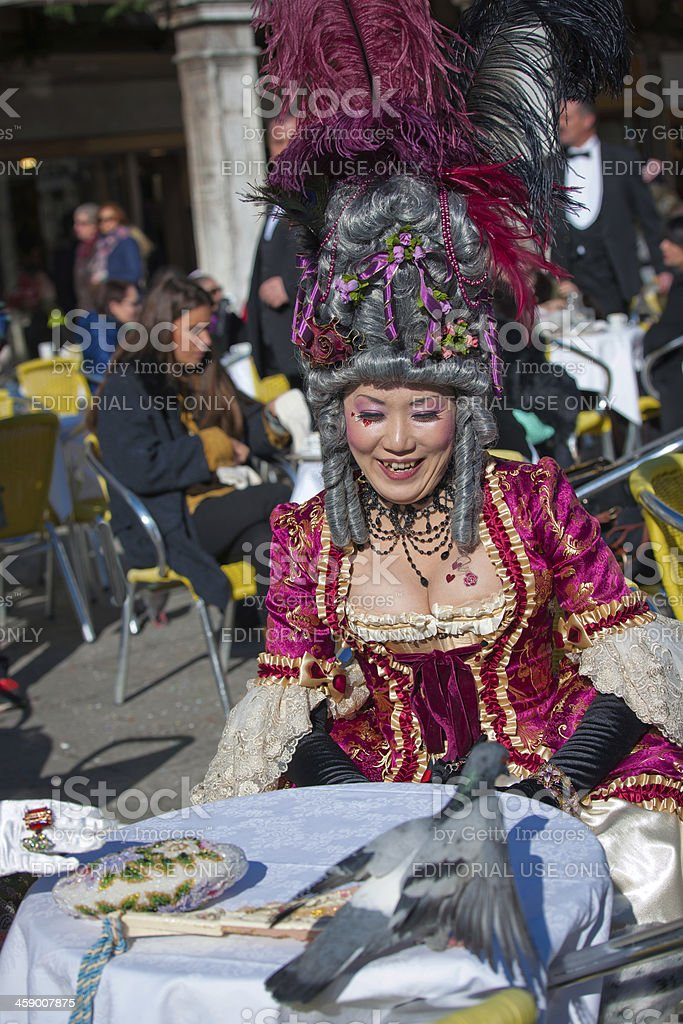 Japonese Noble Woman and Pigeon Venice Italy Carnival 2013 royalty-free stock photo