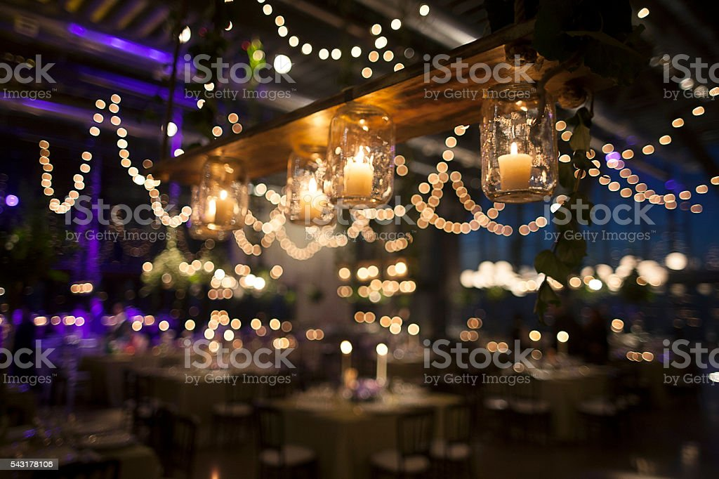 Jar candles to illuminate wedding party stock photo