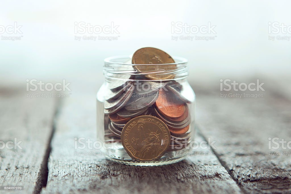 Jar for savings full of coins. stock photo