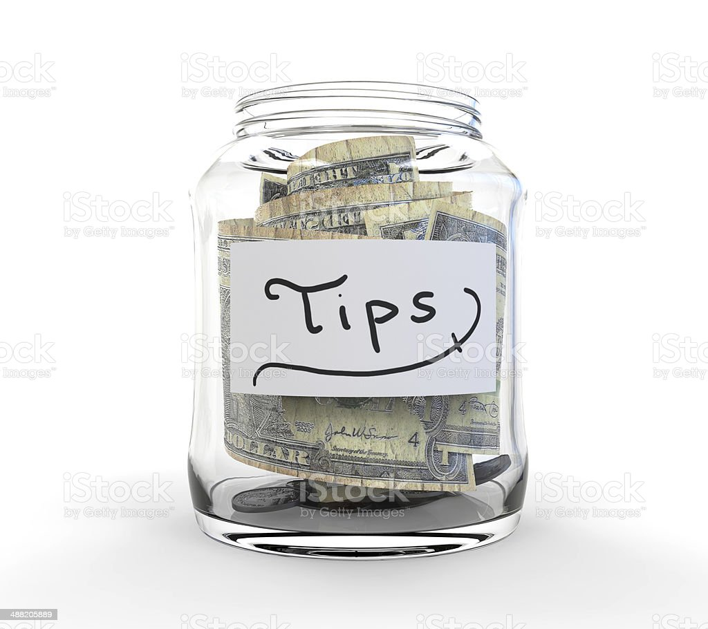 Jar for Tips with Money stock photo