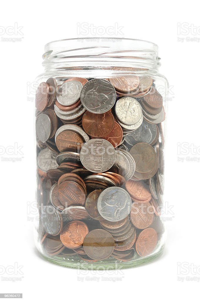 Jar Full of Coins stock photo