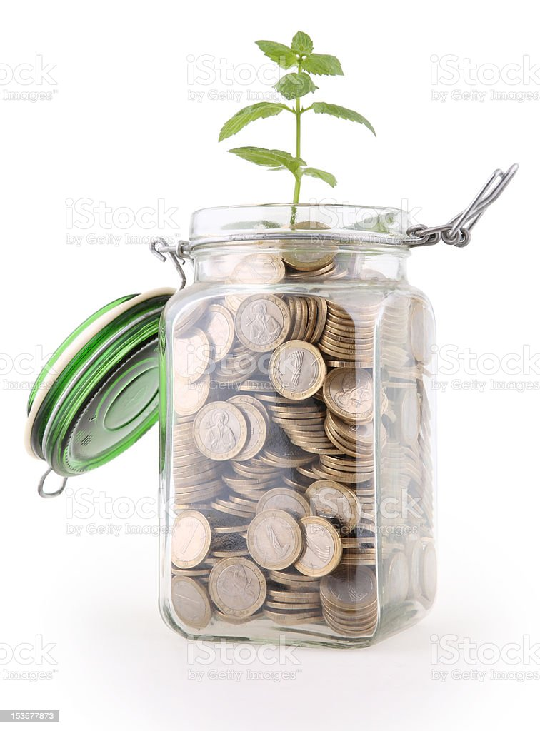 jar full of coins with plant stock photo