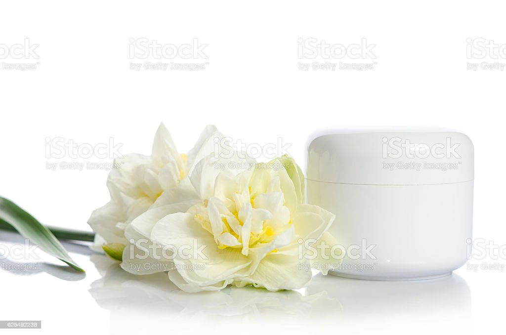 Jar of beauty cream with flowers isolated  on white background stock photo
