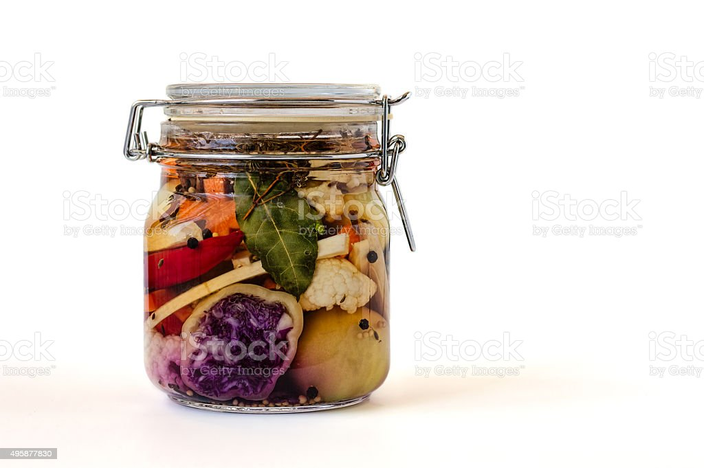 Jar of Brined Lacto-fermented Pickles. stock photo