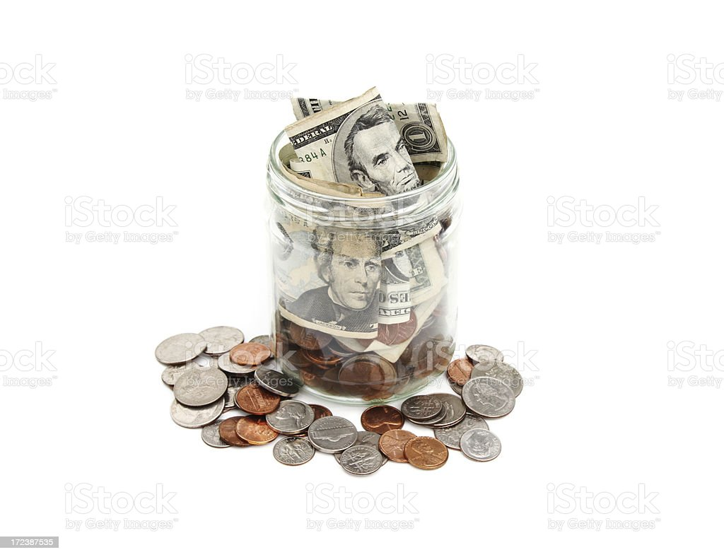 Jar of coins and currency royalty-free stock photo
