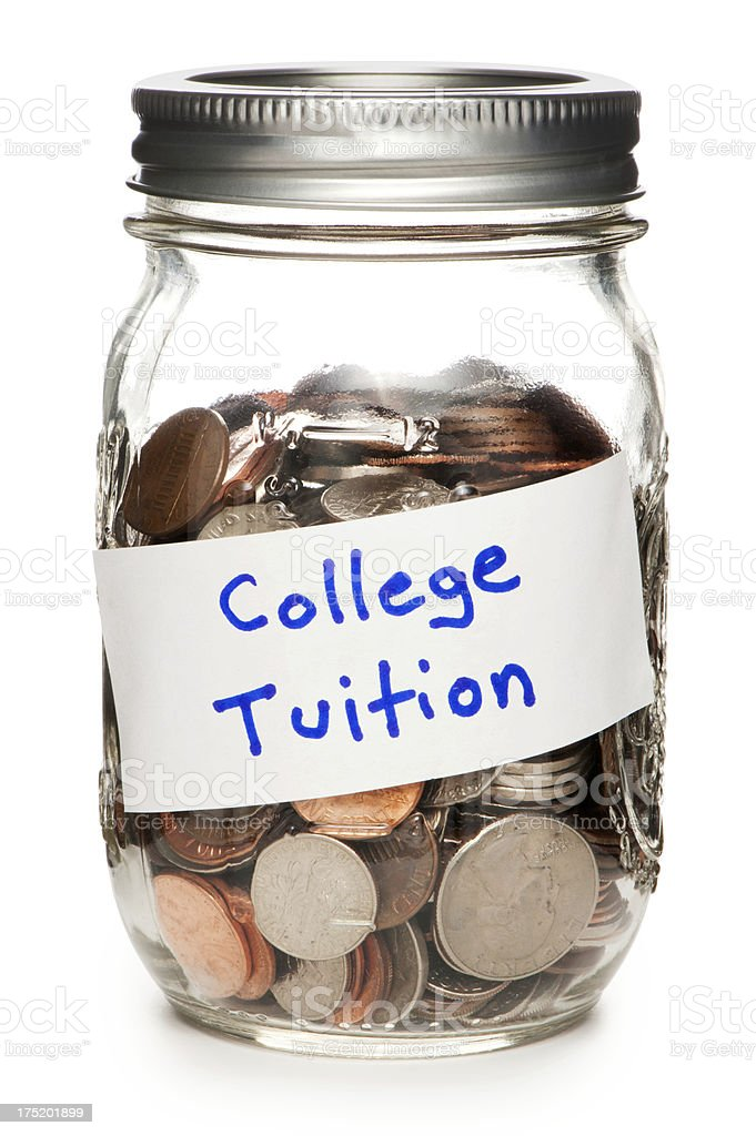 Jar of Coins Labeled College Tuition Isolated on White Background royalty-free stock photo