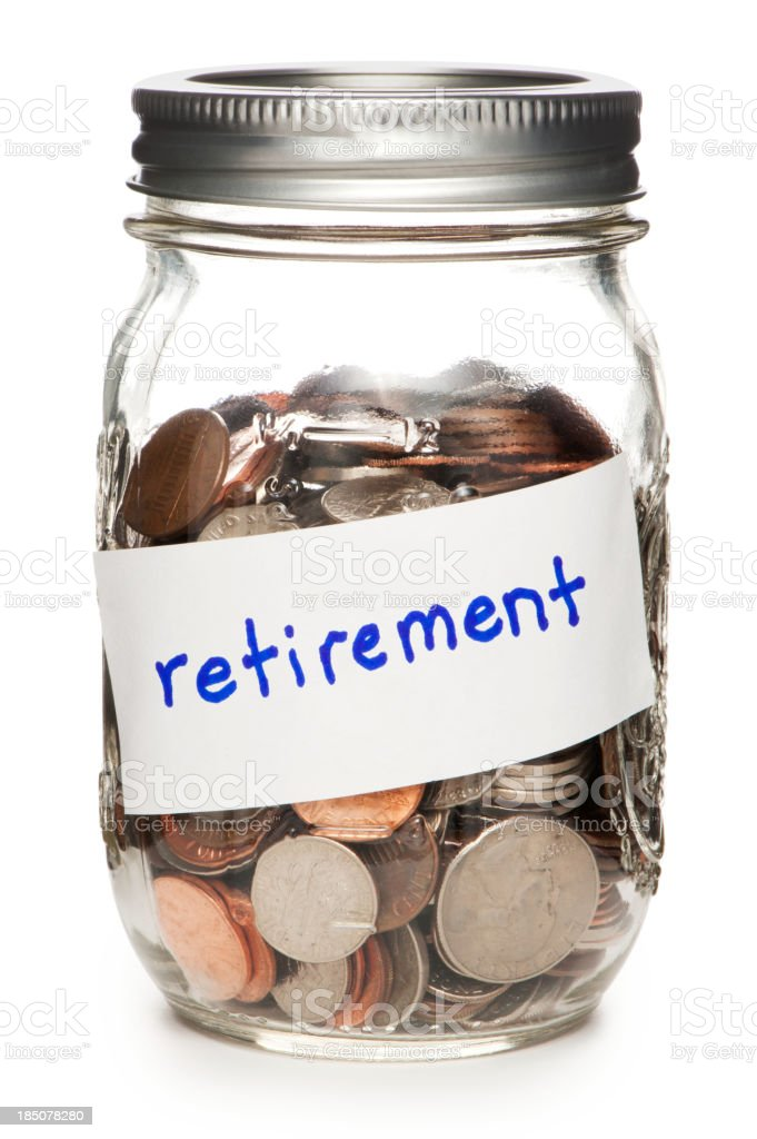 Jar of Coins Labeled Retirement on White stock photo