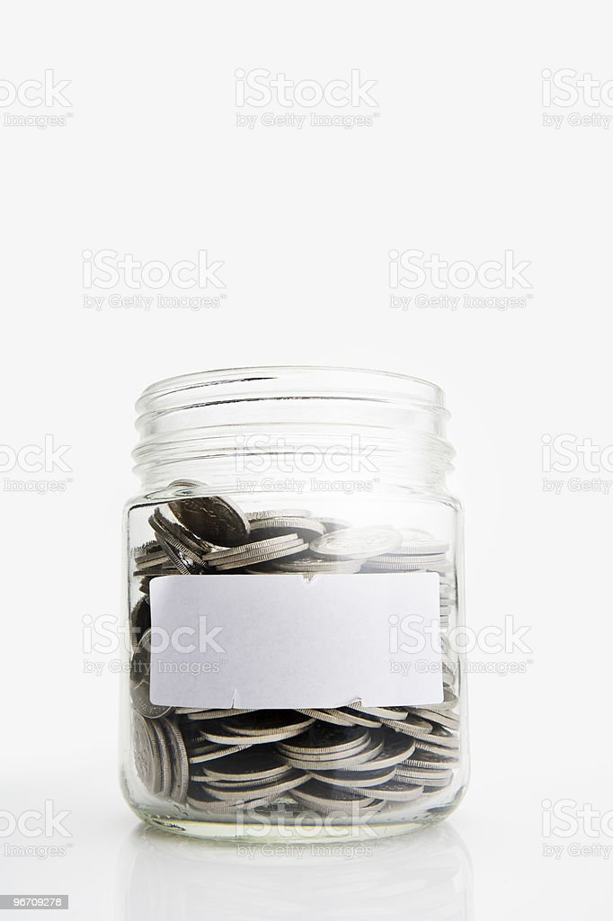Jar of Coins with blank label royalty-free stock photo