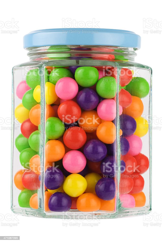 A jar of colorful chewing gums on a white background stock photo