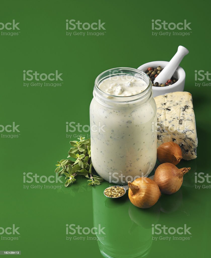 Jar of Creamy Salad dressing with ingredients royalty-free stock photo