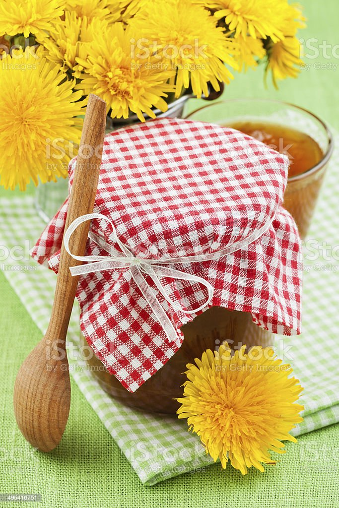 jar of dandelion jam and blowball flowers royalty-free stock photo