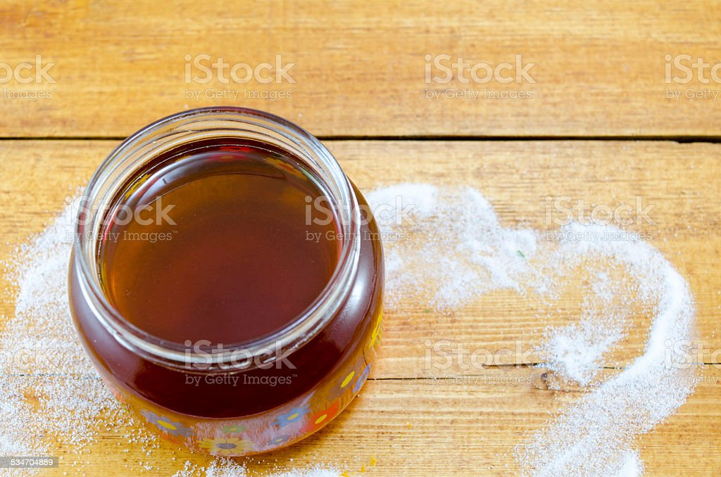 Jar of dark honey on a table royalty-free stock photo