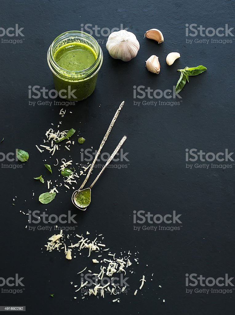 Jar of fresh home made pesto with ingredients for it stock photo