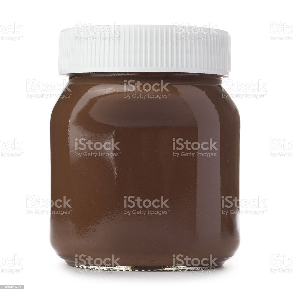 Jar of hazelnut spread on a white background stock photo