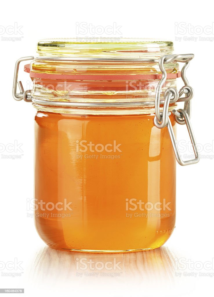 Jar of honey isolated on white royalty-free stock photo