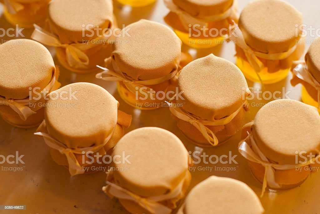 Jar of honey on white table jam confiture marmalade pozzy stock photo