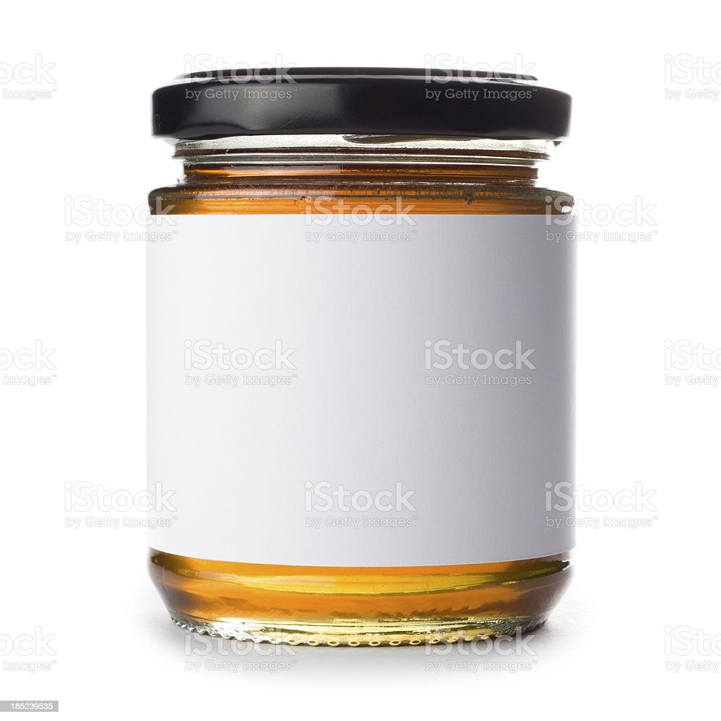 Jar of honey with blank label on a white background stock photo