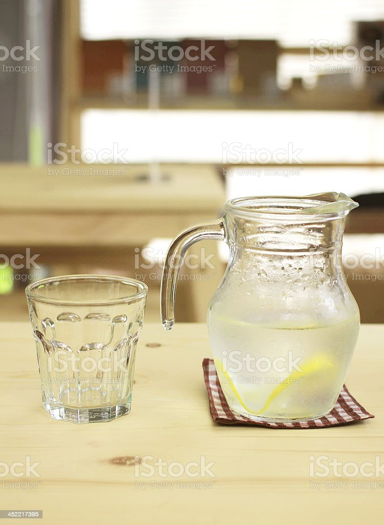 Jar of lemonade with empty glass for summer royalty-free stock photo